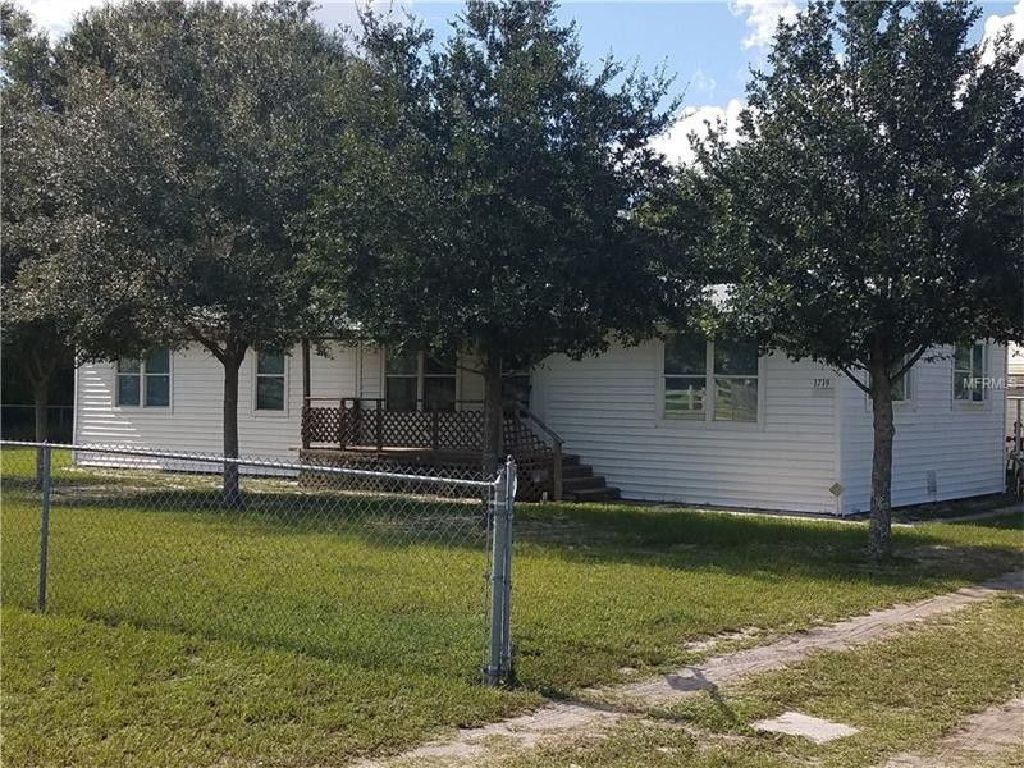 Fenced on over an acre with 2 large storage sheds