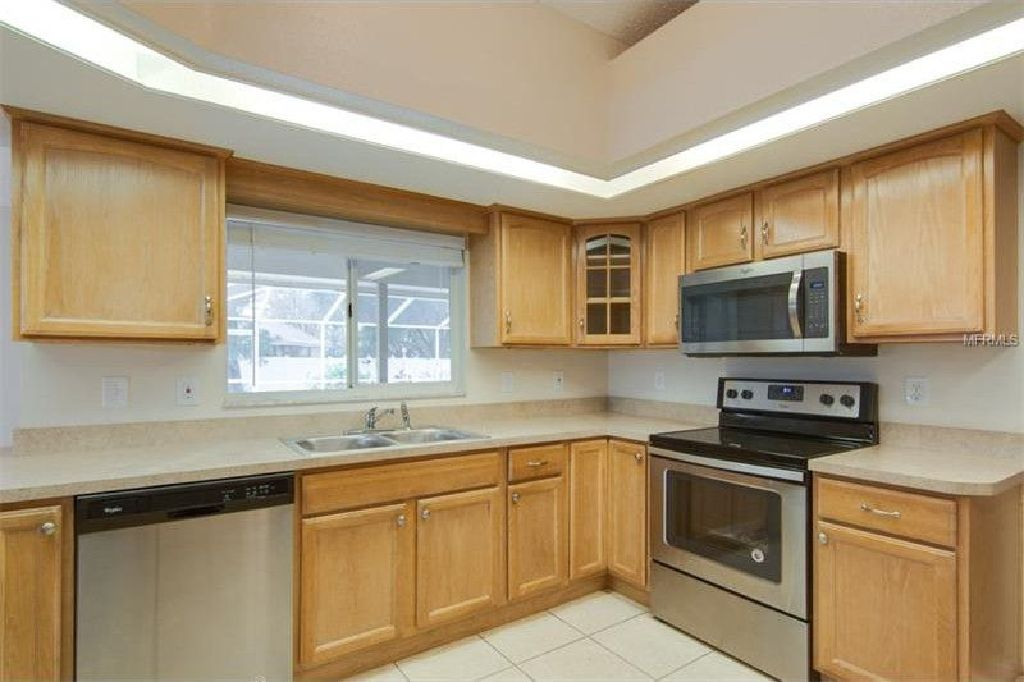 beautifully updated pool home is situated on a 1/3 acre lot