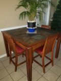 Stone top bar height dining table