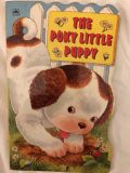 The Poky Little Puppy Hard Cover Book.
