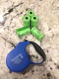Retractable dog leash and waste bags