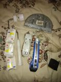 3 earplugs paint roller sheet rock mud tool safety glasses and utility knives