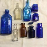 9 assorted old bottles and jars