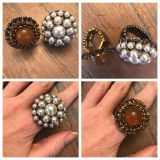 Two stretch pearl and amber rings