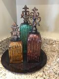 Decorative glass bottles with glass plate