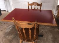 """IN ALVIN Table with 2 solid wood chairs. 46""""x29"""" Metal base. Red laminate top."""