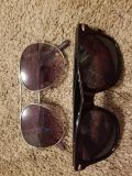 Two pair of sun glasses