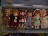 Precious moments collector dolls
