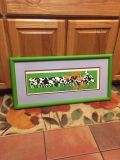 Large cow picture with green frame