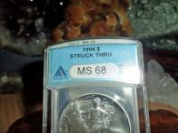 Exceptional and Beautiful American Silver Eagle Dollar {1994-P ANACS Struck Thru
