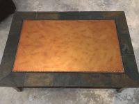Heavy stone and wood coffee table.