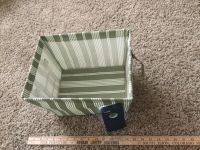 Little canvas type bin with handles, $1.00. Metal frame. Some spots but no holes or rips.