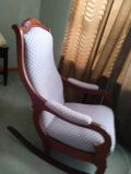 Beautiful upholstered wooden rocking chair with carved wood detailing