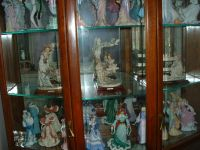 figureens and curio cabinet