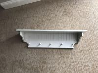 White Wood Wall Shelf with Hanging Pegs and Beadboard Detail
