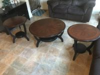 Ashley Furniture Round Circular Coffee Table and 2 round end tables brown expressi