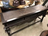 Wooden table with leather top