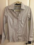 Woman's button down dress shirt from Express. Size M