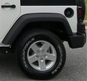 set of stock rims and tires