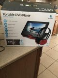 New in box Portable DVD player with case and earphones