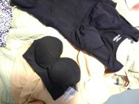 Two cami shirts and a bra