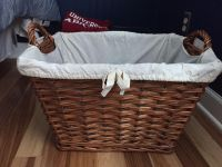 Wicker basket with ivory liner.