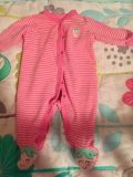 Pink sleeper with strawberry on the back and feet