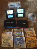 TWO Nintendo 3DS XL Gaming Systems + 8 Games + 2 cases