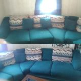Big green couch with pillows