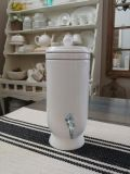 Beautiful white porcelain beverage container with chrome spout.