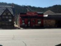 Busy downtown Custer commercial building offering