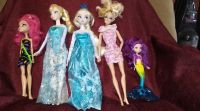 Frozen dolls, Barbie, mermaids and 1 other