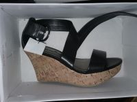 Wedge strapped shoes