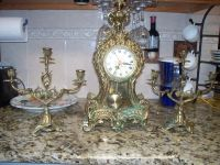 Brass candles and clock