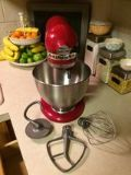 red kitchen aid mixer with attachments