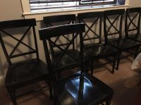 Six rubbed black chairs