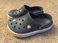 Crocs, size 1, fit my son through size 2, really good used condition, $7. Discount for porch pick up.