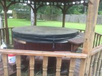 Hot tub ,seats 4 ,with cover, and steps