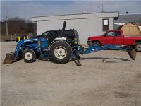 $2,000, 1988 Ford 1920 4wd compact tractor