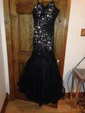 Black diamond prom dress with feather bottom