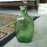 Embossed Collector Glass Bottle