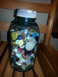 antique canning jar with bottons