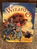 The Wizard Of Ozz. L. Frank Baum. Illustrated by Charles Santors Book. Firm