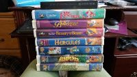 Lot of 8 vhs..one on top without case is lady and the tramp