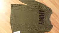Women's long sleeve Army green shirt. Left & right cutouts. With peephole neckline. Size is 1X. Brand is Occasion. New with tag.