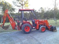 $2,500, Kubota L35 compact tractor with backhoe and loader