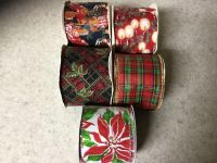 5 rolls of. Christmas ribbons.