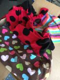 Box of baby girl clothes