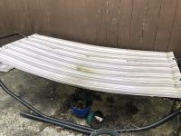 Hammock. Spray painted the frame last year. Only used a few times. Hammock can be washed in washer.