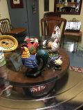 Collection of roosters and chickens and wall hangings